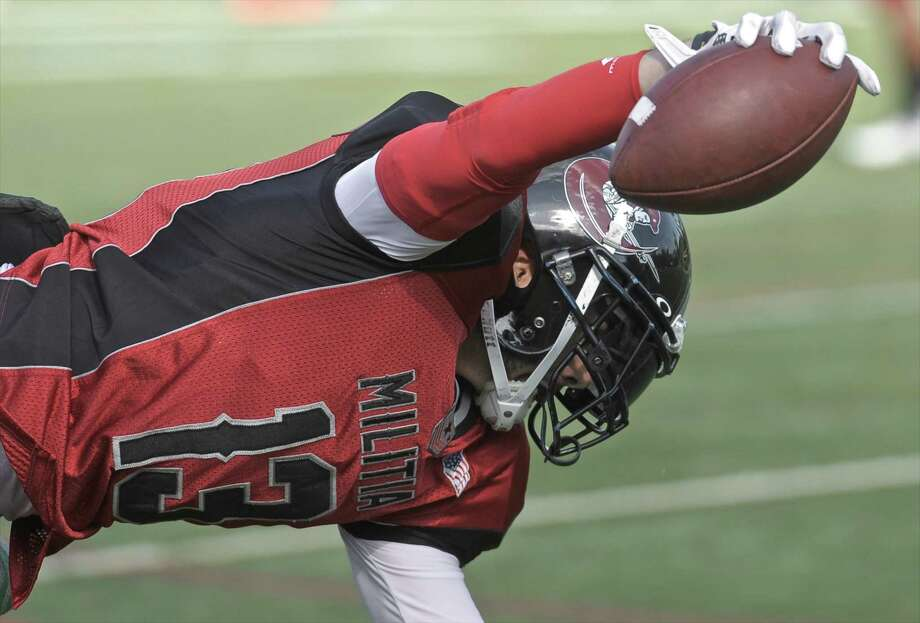 FILE PHOTO: Western Ct Militia's Anthony Julbes (13) reaches over the goal line to score a touchdown during a New England Football League pre-season game between the New Haven Venom and the Western Connecticut Militia at Rogers Park, in Danbury, Conn, on Saturday, June 13, 2015. Photo: H John Voorhees III / Hearst Connecticut Media / The News-Times