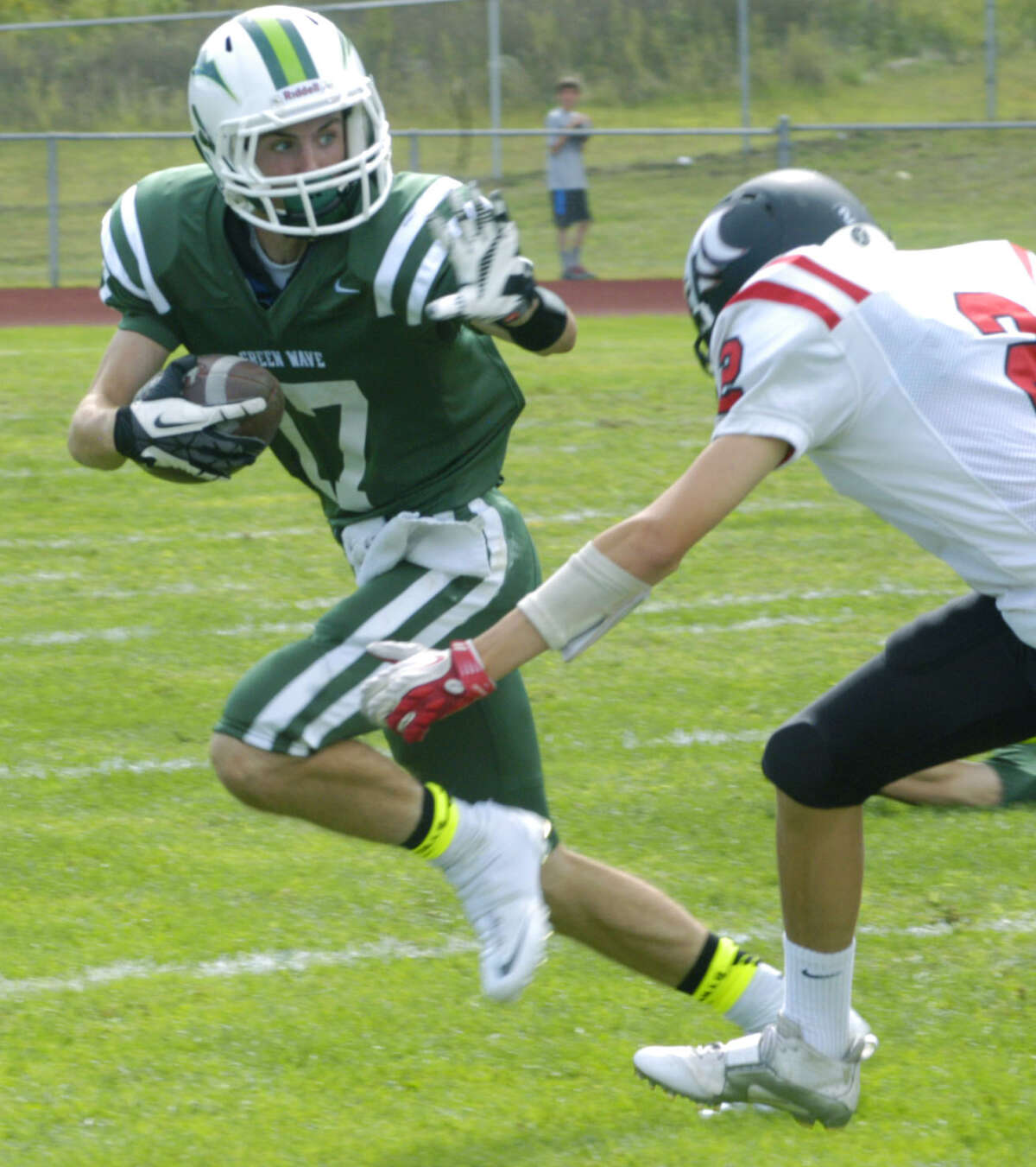 FILE PHOTO: The Green Wave's Nick Kimball eludes a Panther tackler on a kickoff return during New Milford High School football's 71-34 loss to Masuk, Sept. 15, 2013, at NMHS.