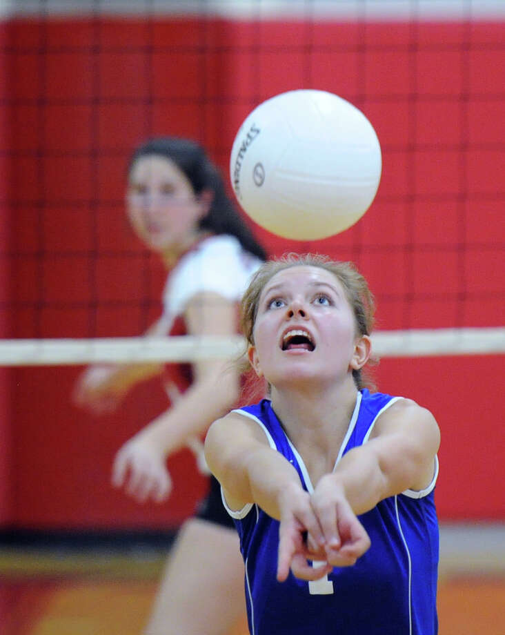 Fairfield Ludlowe High School's Olivia Albenze (#1) returns a shot during the girls volleyball match between Greenwich High School and Fairfield Ludlowe High School at Greenwich, Conn., Tuesday, Sept. 15, 2015. Greenwich won the match, 3-0. Photo: Bob Luckey Jr. / Hearst Connecticut Media / Greenwich Time
