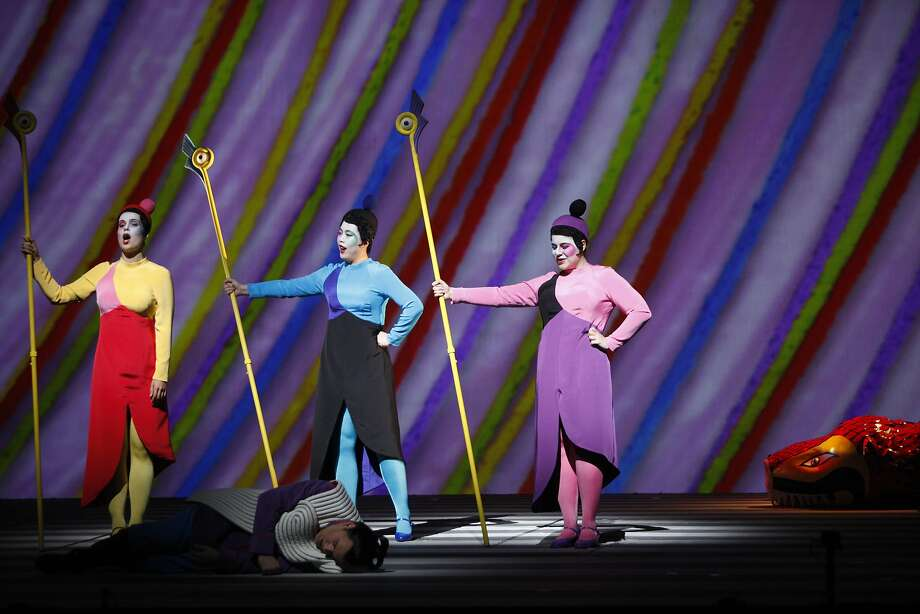 The Three ladies, left to right, Zanda Svede, Nian Wang and Jacqueline Piccolino, stand over Paul Appleby as Tamino, during the dress rehearsal of  Wolfgang Amadeus Mozart's The Magic Flute at the War Memorial Opera House on October 17, 2015. Photo: Franchon Smith, The Chronicle
