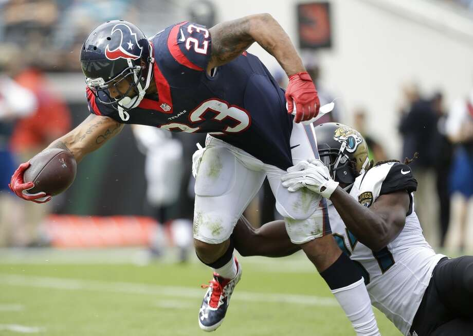 Houston Texans running back Arian Foster (23) pulls away from Jacksonville Jaguars strong safety Johnathan Cyprien (37) as he crosses the goal line for a 14-yard touchdown reception during the first quarter of an NFL football game at EverBank Field on Sunday, Oct. 18, 2015, in Jacksonville. ( Brett Coomer / Houston Chronicle ) Photo: Brett Coomer, Houston Chronicle