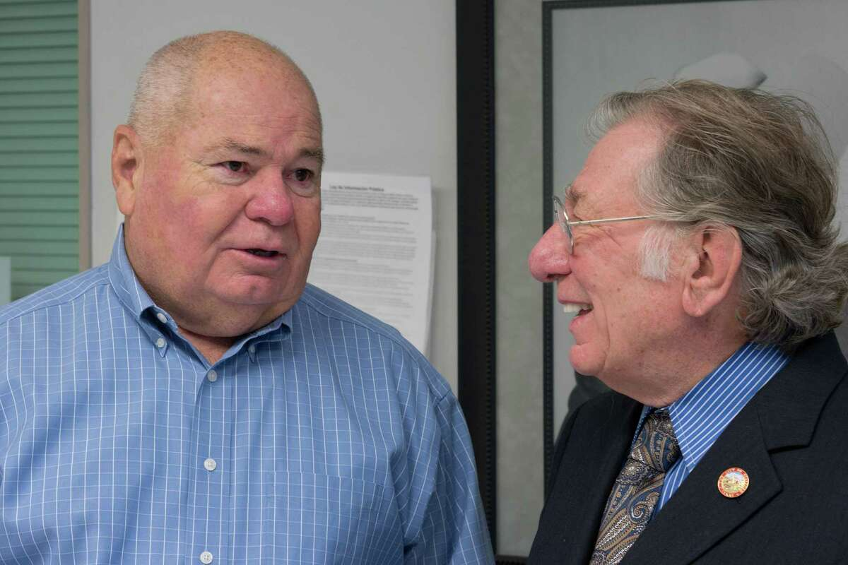 Stafford's retired Police Chief Bonny Krahn, left, and Mayor Leonard Scarcella laugh together Saturday in the Stafford Police Station. Krahn's retirement last month came after 42 years at the police department's helm. His longtime friend Scarcella has been mayor for 46 years.