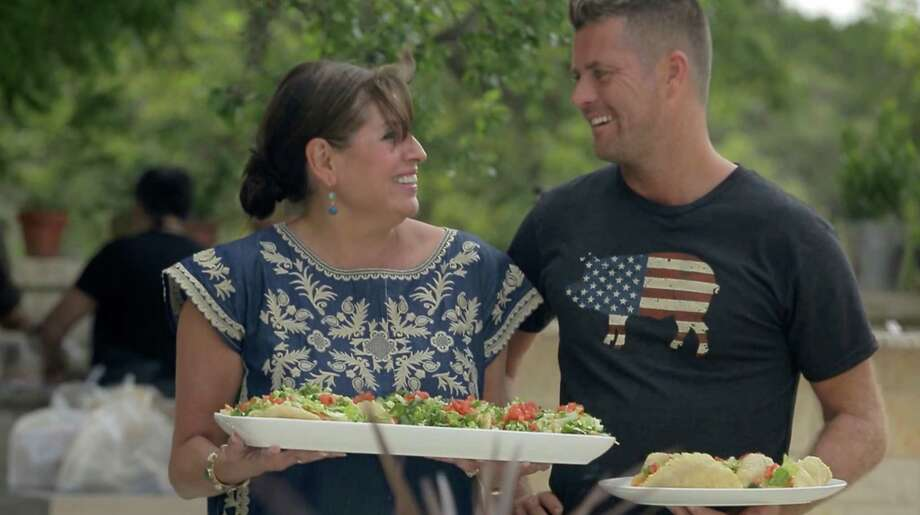 Chef Diana Barrios-Treviño and 'Moveable Feast' Host Pete Evans present her puffy tacos to friends and family member who gathered for the TV episode's special dinner. Photo: Courtesy Of Taunton Press