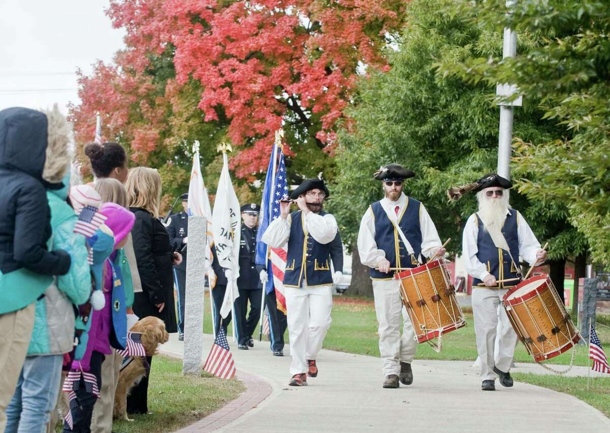 The Germantown Ancients Fife and Drum Corps opens the ceremony at the Danbury War Memorial for the eighth annual Walk of Honor which pays tribute to our country's veterans both past and present. Sunday, Oct. 18, 2015
