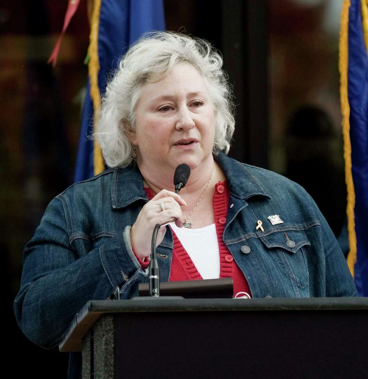Mary Teicholz, founder and organizer of the Walk of Honor, speaks to the gathering at the Danbury War Memorial for the eighth annual walk which pays tribute to our country's veterans both past and present. Sunday, Oct. 18, 2015