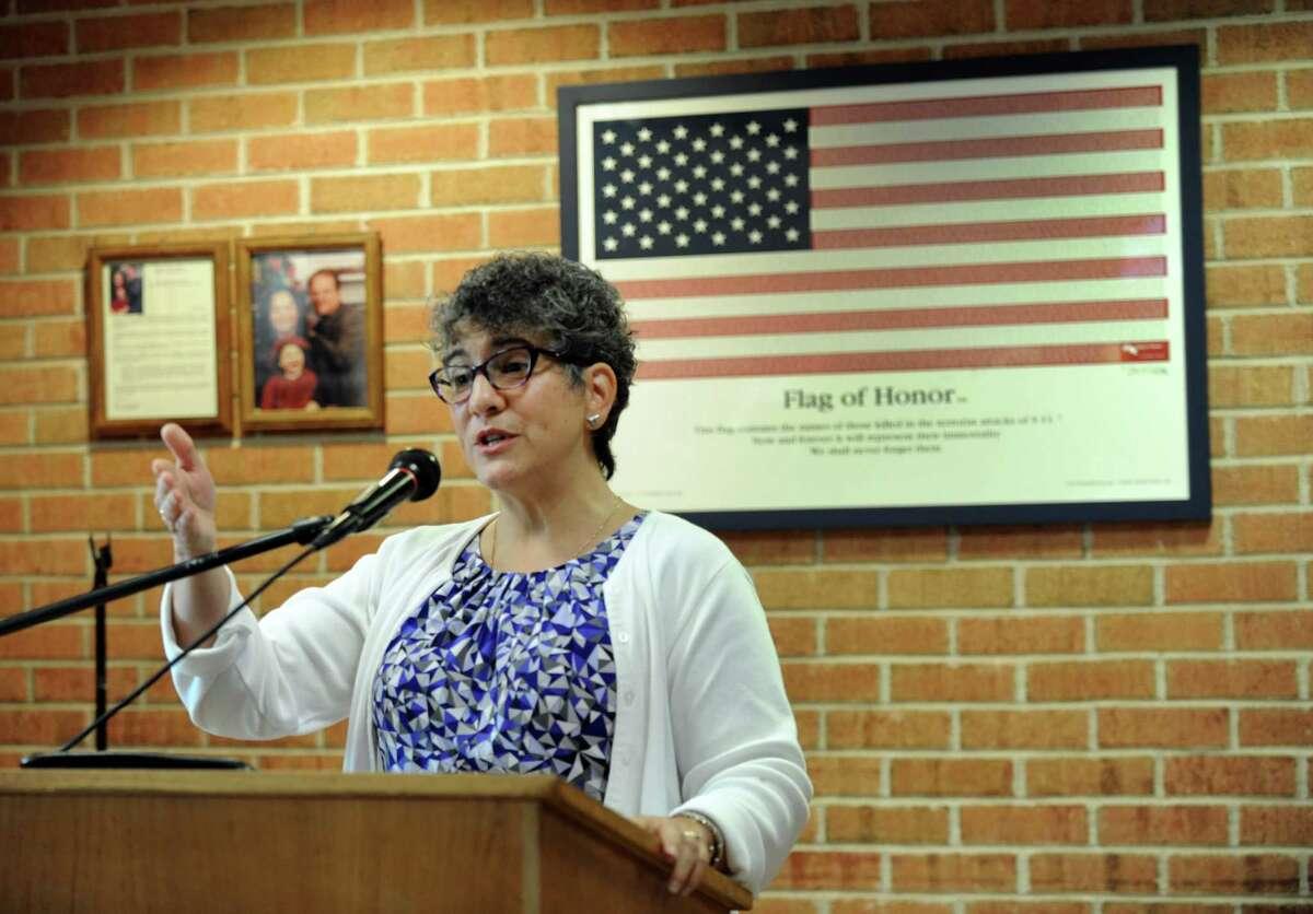 File photo of Joel Barlow Interim Principal Gina Pin speaking during the school's 9/11 ceremony Friday, Sept. 11, 2015.