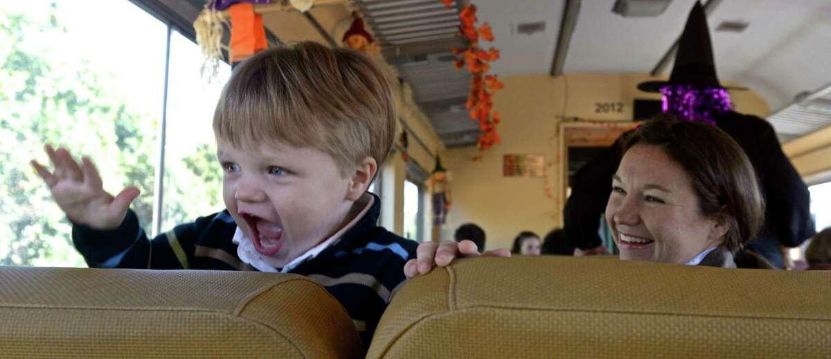 Lauren Burkhart, of Newtown, watches her son, Declan Hume, 2, show his excitement as the Danbury Railway Museum annual train departs to the pumpkin patch.