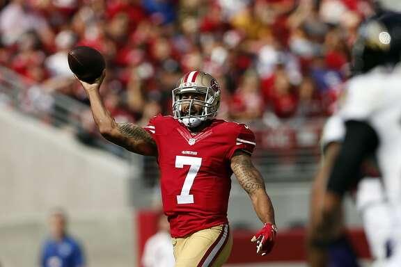 San Francisco 49ers' Colin Kaepernick passes in 1st quarter against Baltimore Ravens during NFL game at Levi's Stadium in Santa Clara, Calif., on Sunday, October 18, 2015.