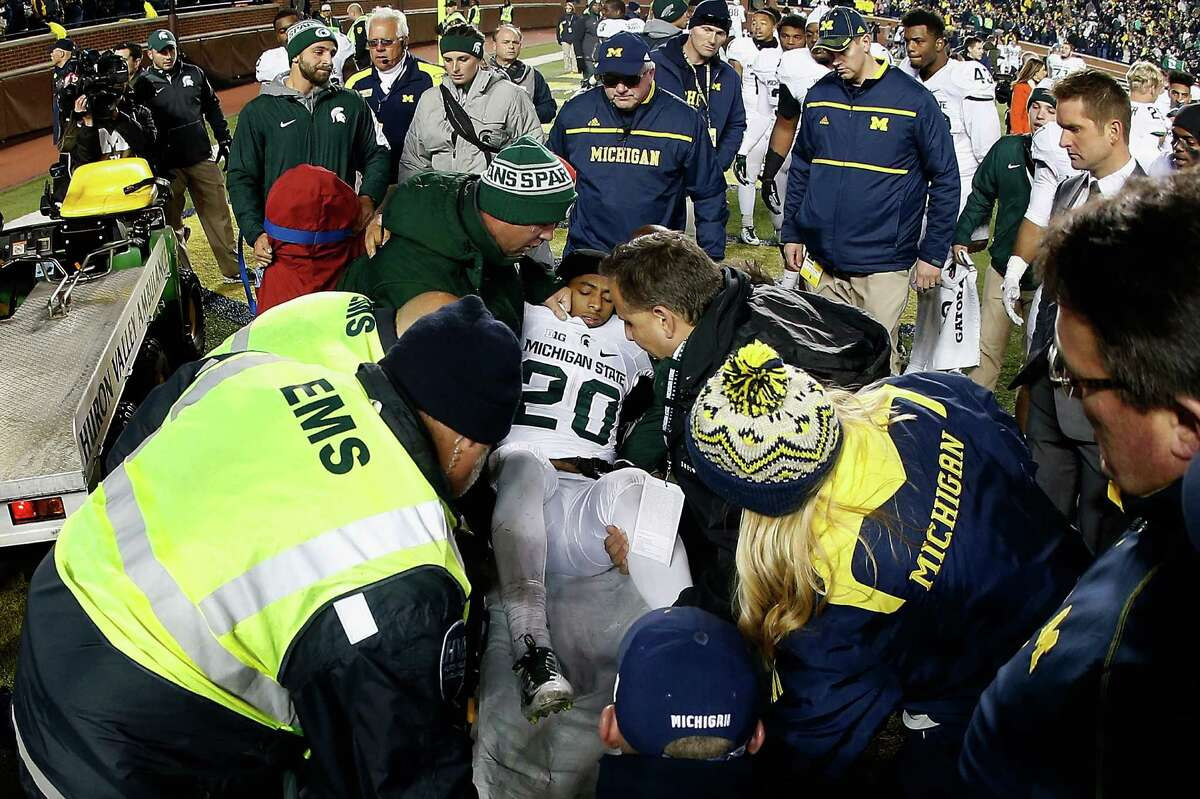 ANN ARBOR, MI - OCTOBER 17: Defensive back Jalen Watts-Jackson #20 of the Michigan State Spartans is lifted onto a stretcher after being injured on his game winning 38 yard touchdown against the Michigan Wolverines following the college football game at Michigan Stadium on October 17, 2015 in Ann Arbor, Michigan. The Spartans defeated the Wolverines 27-23. (Photo by Christian Petersen/Getty Images)