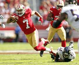 San Francisco 49ers' Colin Kaepernick is tripped up by Baltimore Ravens' Jimmy Smith in 2nd quarter during NFL game at Levi's Stadium in Santa Clara, Calif., on Sunday, October 18, 2015.