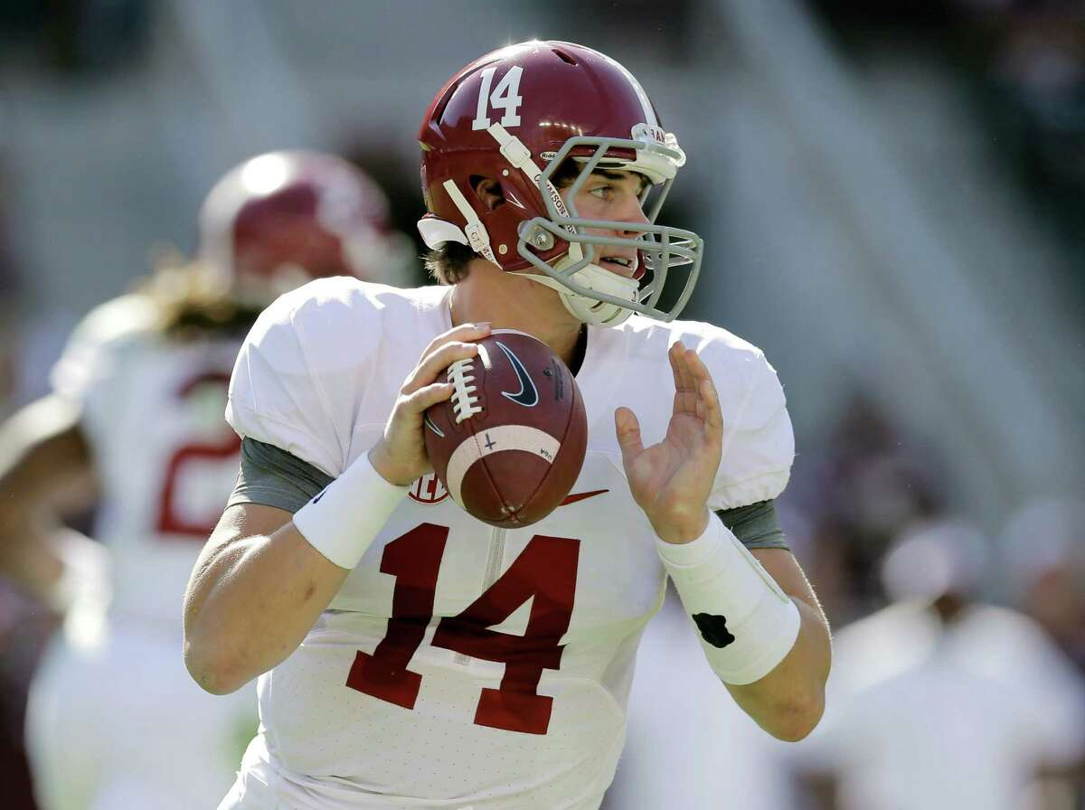 Alabama 's Jake Coker (14) looks to pass against Texas A&M during the first half of an NCAA college football game, Saturday, Oct. 17, 2015, in College Station, Texas. (AP Photo/Eric Gay)