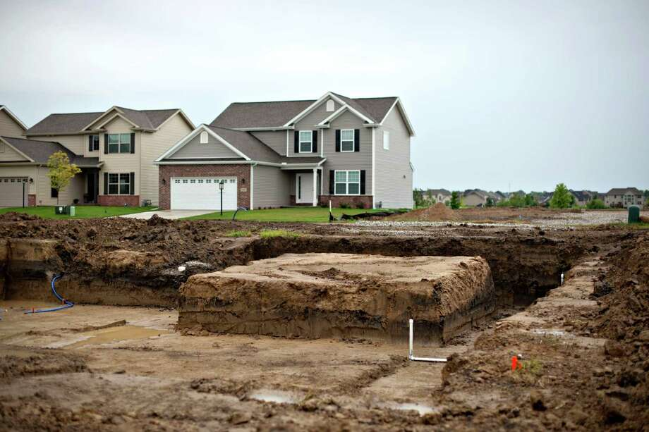 """Pipes run into the foundation hole of a home under construction in Peoria, Illinois. Fed Chair Janet Yellen has highlighted the pace of groundbreaking as a trouble spot for a housing market that's still """"very depressed"""" since the downturn. However, other indicators are showing more promise. Photo: Bloomberg News File Photo / © 2014 Bloomberg Finance LP"""
