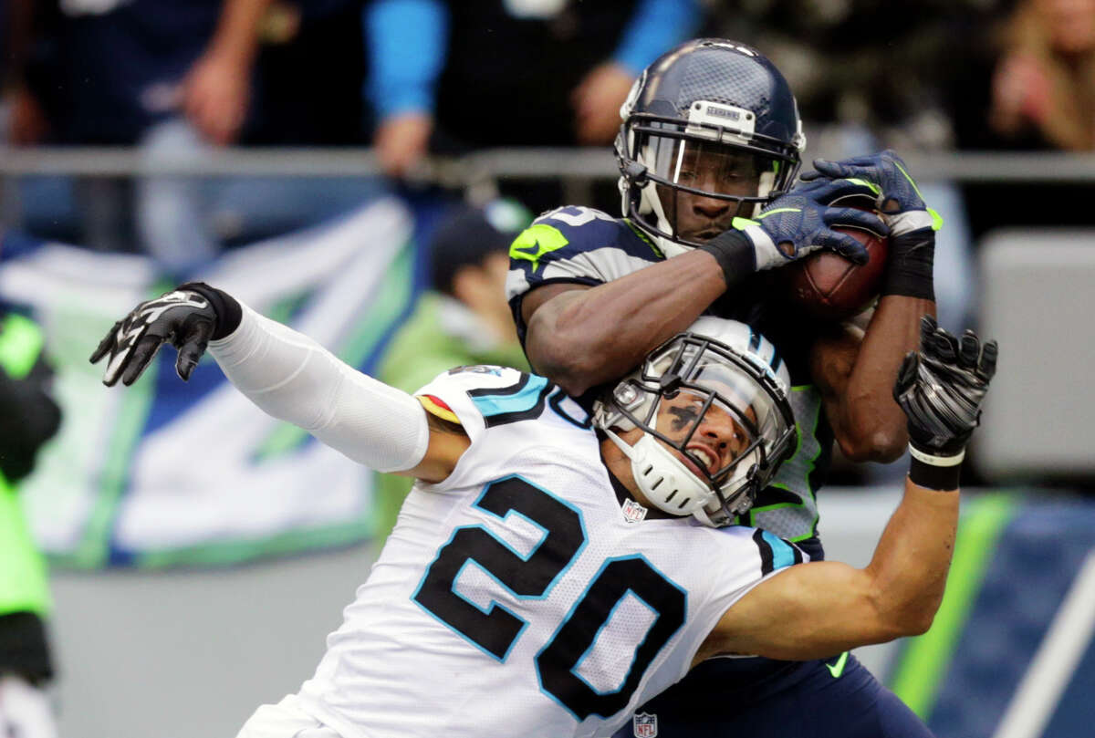 Seattle Seahawks wide receiver Ricardo Lockette (83) makes a touchdown catch above Carolina Panthers free safety Kurt Coleman (20) in the second half of an NFL football game, Sunday, Oct. 18, 2015, in Seattle. (AP Photo/Stephen Brashear)