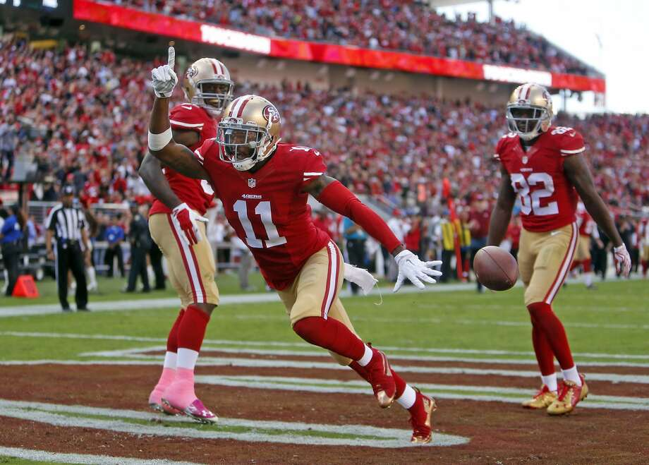 San Francisco 49ers' Quinton Patton celebrates his 4th quarter touchdown catch with Vernon Davis and Torrey Smith during Niners' 25-20 win over Baltimore Ravens in NFL game at Levi's Stadium in Santa Clara, Calif., on Sunday, October 18, 2015. Photo: Scott Strazzante, The Chronicle