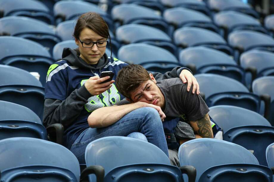 Dejected Seattle Seahawks fans sit in the stands after the team's 27-23 loss to the Carolina Panthers on Oct. 18, 2015 at CenturyLink Field in Seattle. (Joshua Trujillo/seattlepi.) Photo: JOSHUA TRUJILLO, Seattlepi.com / SEATTLEPI.COM