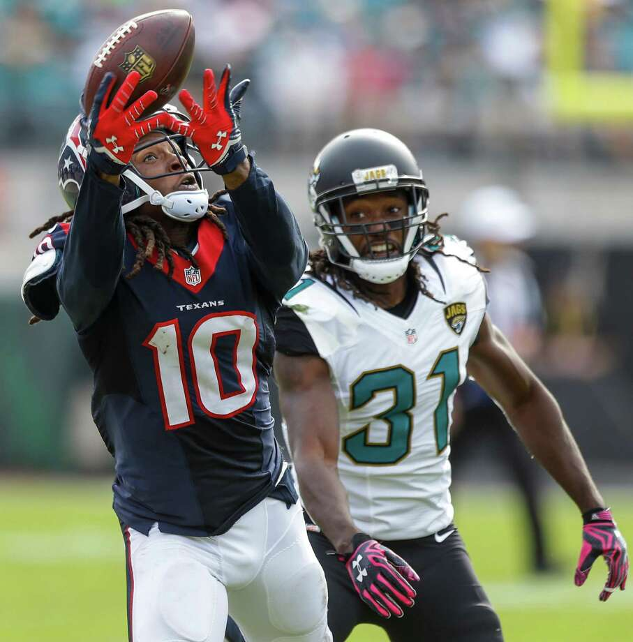 Texans receiver DeAndre Hopkins hauls in a pass from Brian Hoyer despite the efforts of Jaguars cornerback Davon House in the fourth quarter. On the day, Hoyer and Hopkins took it to Jacksonville 10 times for 148 yards and two touchdowns, with both TDs coming in the fourth quarter. Photo: Brett Coomer, Staff / © 2015  Houston Chronicle