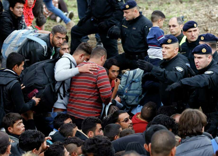 Croatian police said more than 5,000 migrants have entered the country since Hungary closed its border, citing security concerns and a desire to protect the European Union from an uncontrolled flow of people. Photo: Darko Vojinovic, STF / AP