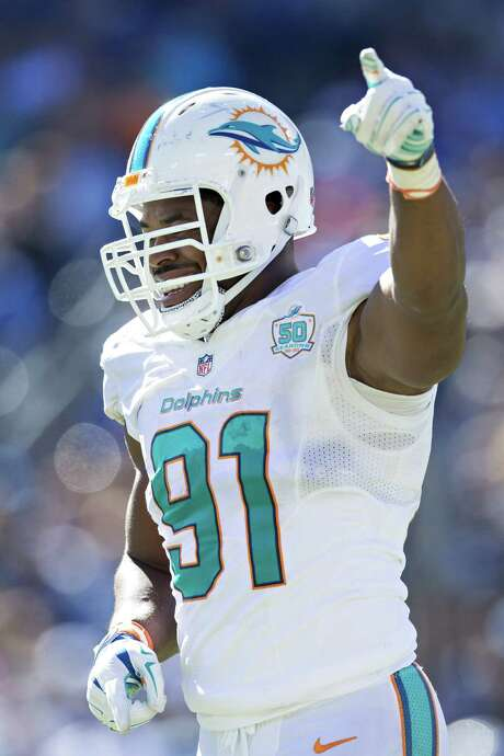 NASHVILLE, TN - OCTOBER 18:  Cameron Wake #91 of the Miami Dolphins celebrates after sacking the quarterback during a game against the Tennessee Titans at LP Field on October 18, 2015 in Nashville, Tennessee.  The Dolphins defeated the Titans 38-10.  (Photo by Wesley Hitt/Getty Images) Photo: Wesley Hitt, Stringer / 2015 Getty Images