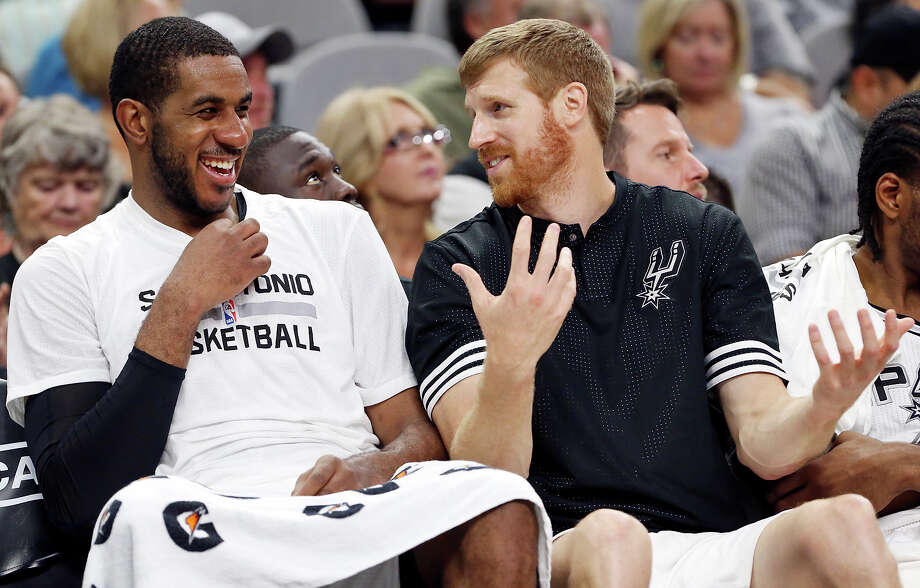 Spurs' LaMarcus Aldridge jokes with Matt Bonner while on the bench during second half action against the Detroit Pistons on Oct. 18, 2015 at the AT&T Center. The Spurs won the preseason game 96-92. Photo: Edward A. Ornelas /San Antonio Express-News / © 2015 San Antonio Express-News