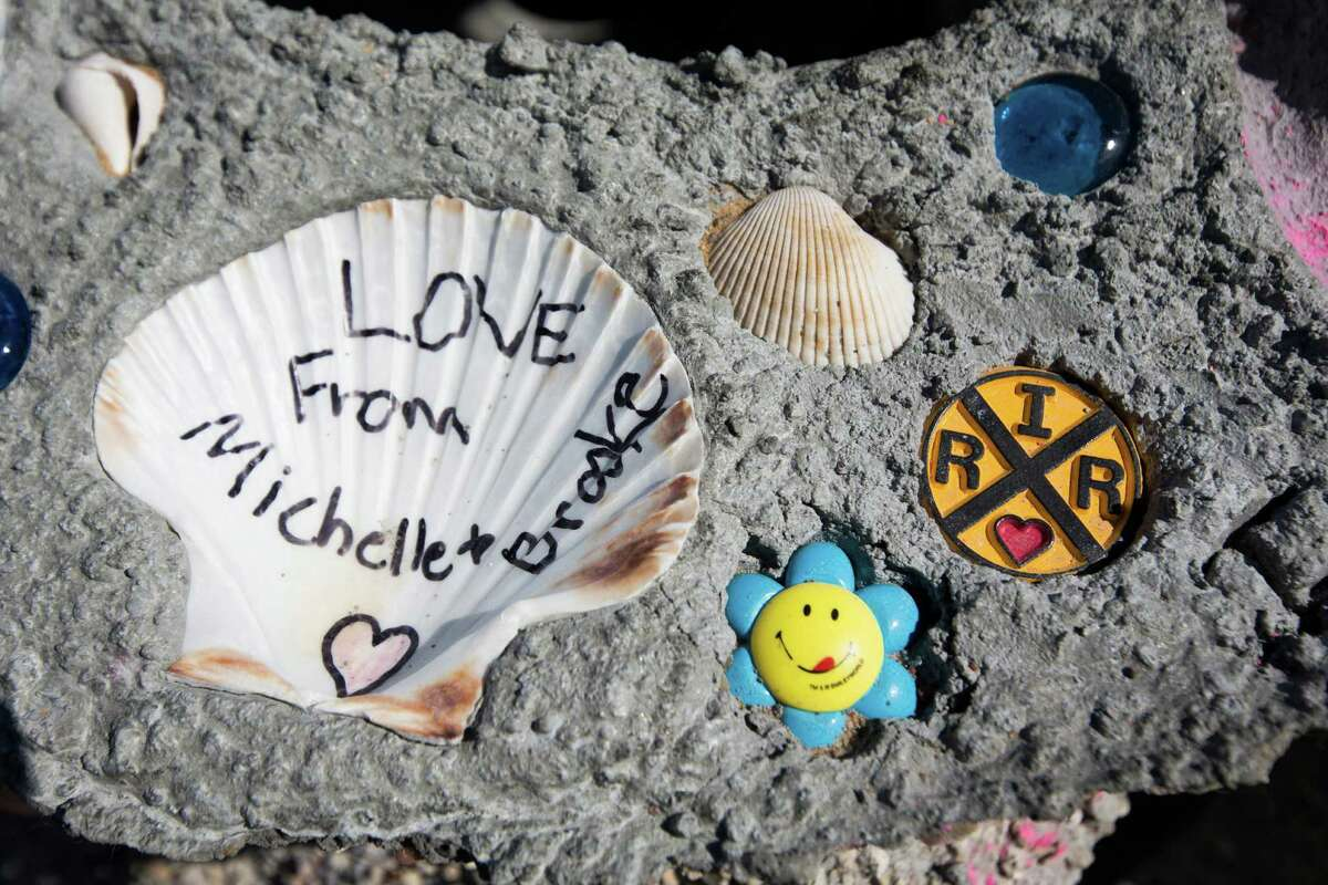 Michelle and Brooke White left behind mementos on the reef structure of their grandparents, Dick and Helen Gabler. dedicated shells and a railroad themed piece on the Eternal Reefs structure of their grandparents during a memorial, Sunday, Oct. 18, 2015, in Galveston. The ashes of Dick Gabler and Helen Gabler has been mixed with the cement that will become a reef in the Gulf of Mexico. ( Marie D. De Jesus / Houston Chronicle )