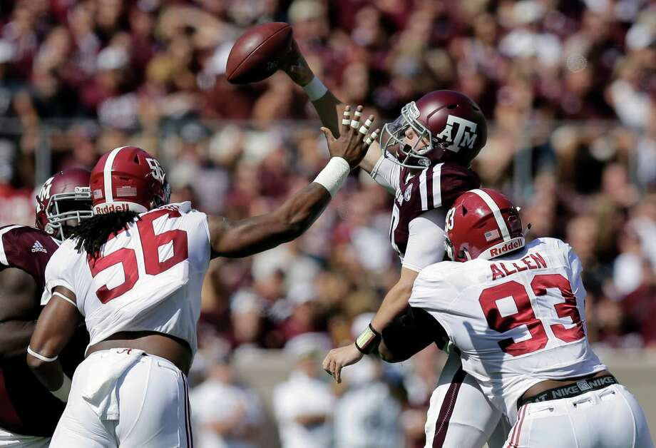 Texas A&M quarterback Kyle Allen, center, is pressured by Alabama's Tim Williams (56) and Jonathan Allen (93) as he tries to pass during the first half of an NCAA college football game, Saturday, Oct. 17, 2015, in College Station. Photo: Eric Gay /Associated Press / AP