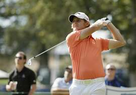 Emiliano Grillo, of Argentina, follows his shot from the seventh tee of the Silverado Resort North Course during the final round of the Frys.com golf tournament Sunday, Oct. 18, 2015, in Napa, Calif. (AP Photo/Eric Risberg)