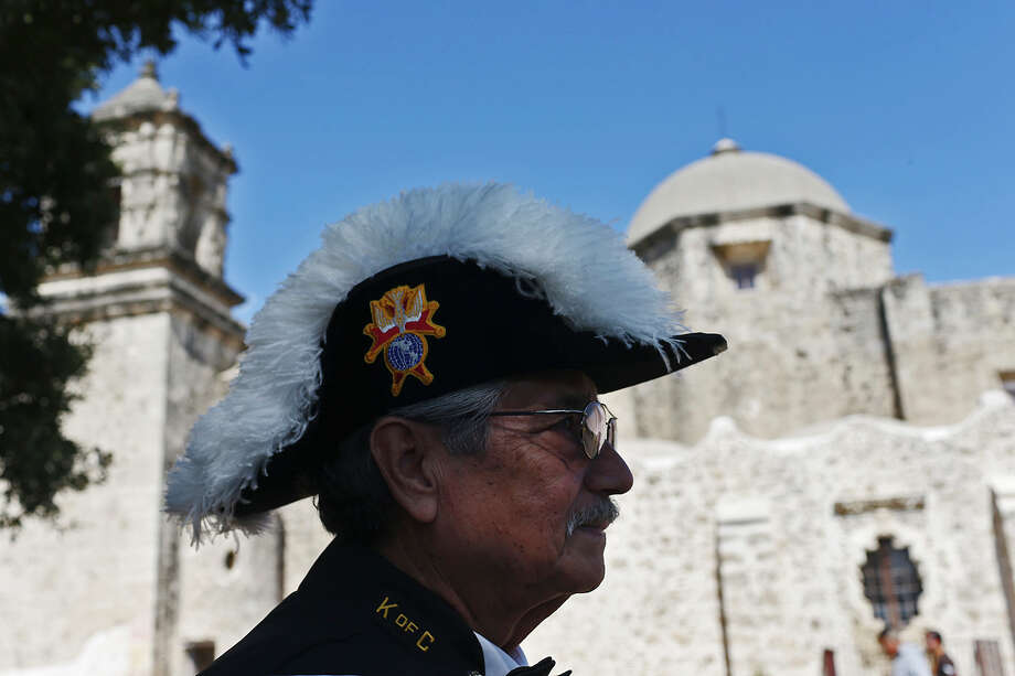 Pedro Ybarra, member of the Knights of Columbus Assembly 1855, waits for other members before a mass celebrating the San Antonio Missions' World Heritage Inscription at Mission San Jose on Oct. 18. The city of San Antonio must make sure harmful development doesn't occur around any of hte missions. Photo: JERRY LARA /San Antonio Express-News / © 2015 San Antonio Express-News