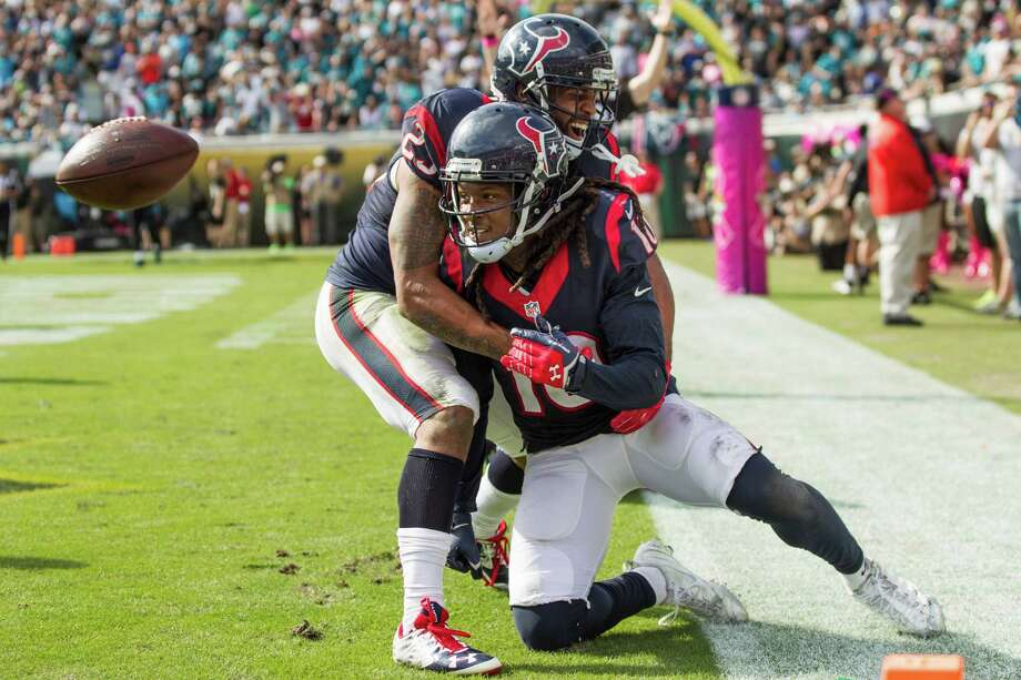 Arian Foster, left, joins DeAndre Hopkins to celebrate the first of Hopkins' two touchdown catches Sunday, a 9-yarder in the fourth quarter. Photo: Brett Coomer, Staff / © 2015  Houston Chronicle