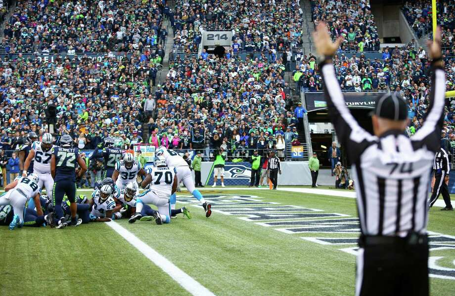 Carolina Panthers player Jonathan Stewart crosses the goal line for a third quarter touchdown against the Seattle Seahawks on Sunday, October 18, 2015. Photo: JOSHUA TRUJILLO, SEATTLEPI.COM / SEATTLEPI.COM