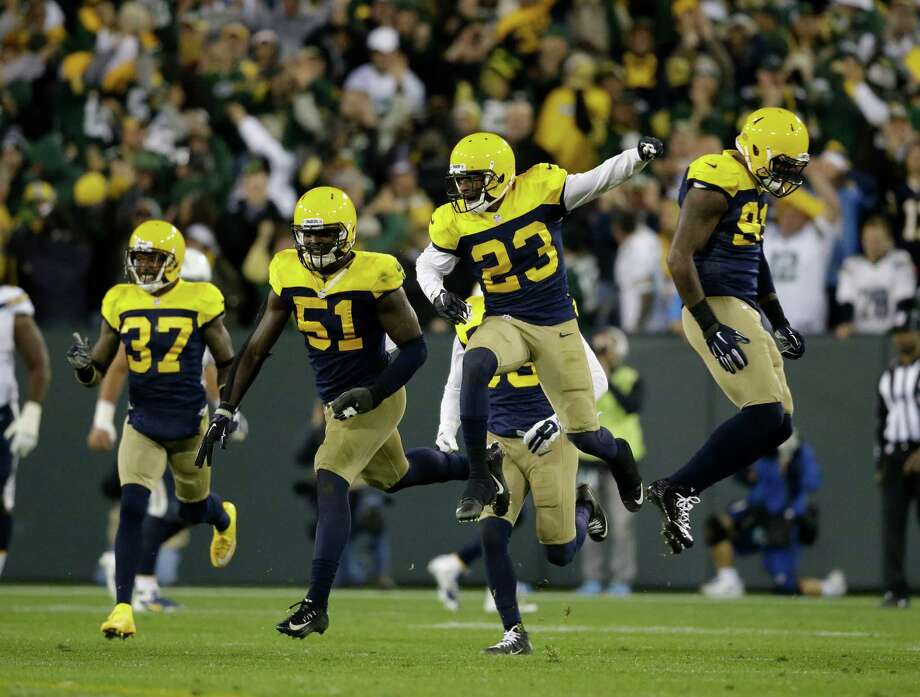 Green Bay's Damarious Randall (23) leads the celebration after breaking up Philip Rivers' pass intended for San Diego's Danny Woodhead at the goal line on the final play Sunday to preserve the Packers' 27-20 victory. Photo: Jeffrey Phelps, FRE / FR59249 AP