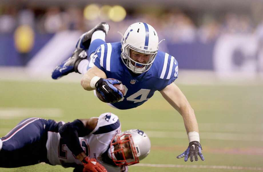 INDIANAPOLIS, IN - OCTOBER 18: Jack Doyle #84 of the Indianapolis Colts leaps for extra yardage during the game against the New England Patriots at Lucas Oil Stadium on October 18, 2015 in Indianapolis, Indiana.  (Photo by Andy Lyons/Getty Images) Photo: Andy Lyons, Staff / 2015 Getty Images
