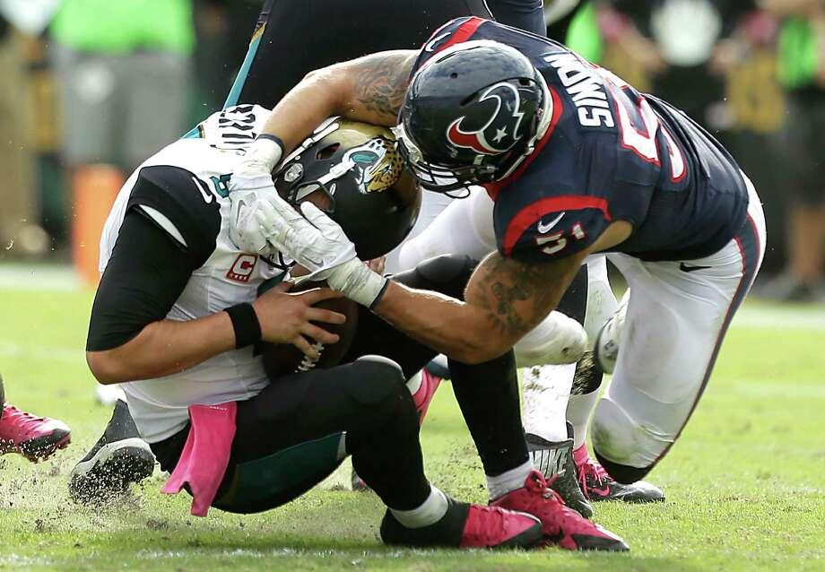 Linebacker John Simon gets to Jaguars quarterback Blake Bortles during the Texans' dominant fourth quarter. Whitney Mercilus had the other two sacks for the Texans. Photo: Brett Coomer, Staff / © 2015  Houston Chronicle