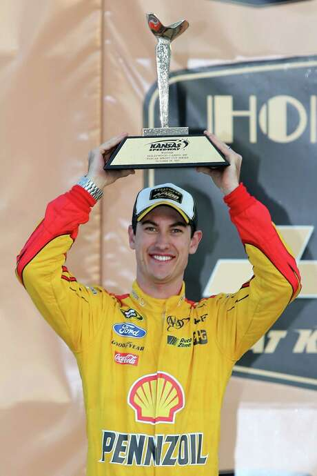 KANSAS CITY, KS - OCTOBER 18:  Joey Logano, driver of the #22 Shell Pennzoil Ford, poses in Victory Lane after winning the NASCAR Sprint Cup Series Hollywood Casino 400 at Kansas Speedway on October 18, 2015 in Kansas City, Kansas.  (Photo by Jerry Markland/Getty Images) Photo: Jerry Markland, Stringer / 2015 Getty Images