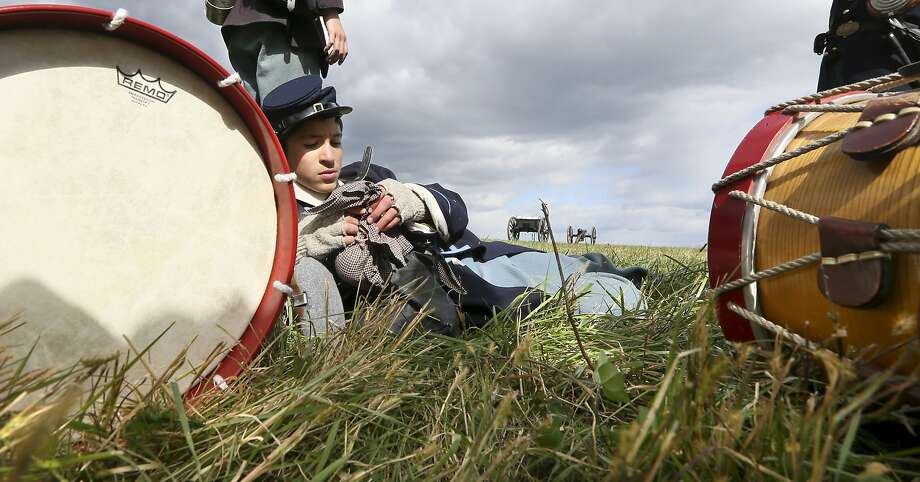 George Rioseco leans on his drum as he opens a food sack during a break at the reenactment of the Civil War Battle of Cedar Creek on Sunday Oct. 18, 2015, at the Cedar Creek battlefield just south of Middletown, Va. The 151st anniversary commemoration weekend was hosted by the Cedar Creek and Belle Grove National Historical Park. Photo: Ginger Perry, Associated Press