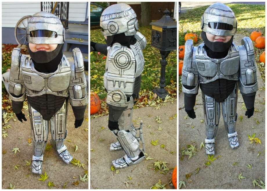 ROBOCOP (2014): We had an especially large number of costumes based on 1980s movies in 2014, but 5-year-old Livi takes the prize in a competitive field because, 1) She chose the costume herself, after seeing some of mom and dad's movie memorabilia; and 2) We like the feminist message of a 5-year-old female Robocop. Thanks to mom Katrina Schoonover for the entry.