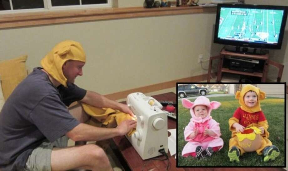 """PIGLET w/ DAD (2013): Parents Shannon and Warwick bought a sewing machine for these Piglet and Winnie the Pooh costumes, and Shannon reports that her """"middle-aged beer-drinkin' sports-lovin' husband figured out how to work the thing and sewed the costumes himself."""" Just as I started to tear up reading that, I realized she sent a photo of Warwick, and I started laughing and tearing up at the same time. Parents of the year. Some day this is going to come up in a wedding toast … Photo: Courtesy Shannon A."""