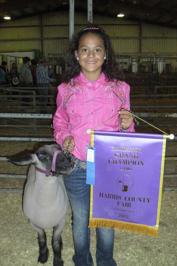 Ten-year-old Jessica Donalson won grand champion with her lamb Nevada at the 2015 Harris County Fair. Photo: Karen Zurawski