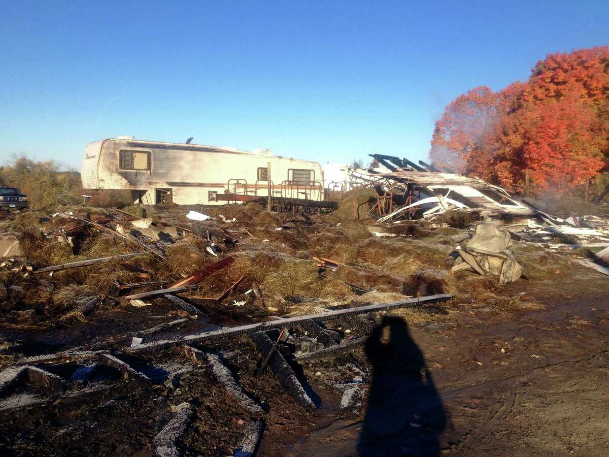 A fire Sunday at 55 Ridge Road destroyed a hay barn and its contents. About 100 firefighters responded to the blaze. The barn was rented by Dan Weed, a Bridgewater farmer, who stored hay, tractor and milking equipment there. Only smoldering remains were left Monday. Oct. 19, 2015