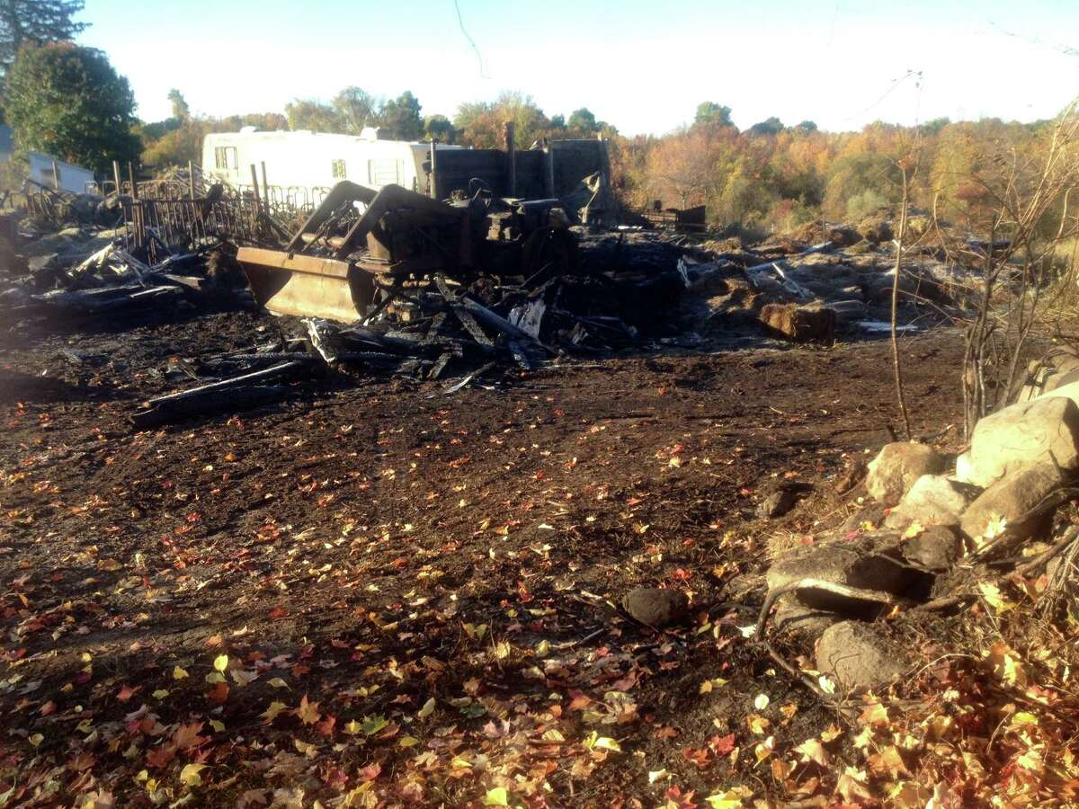 A fire Sunday destroyed a hay barn leaving only smoldering remains of the hay, tractor, milking equipment and other farm equipment stored there. The barn was rented by Bridgewater farmer Dan Weed. About 100 firefighters responded to the blaze and as back up. Oct. 20, 2015