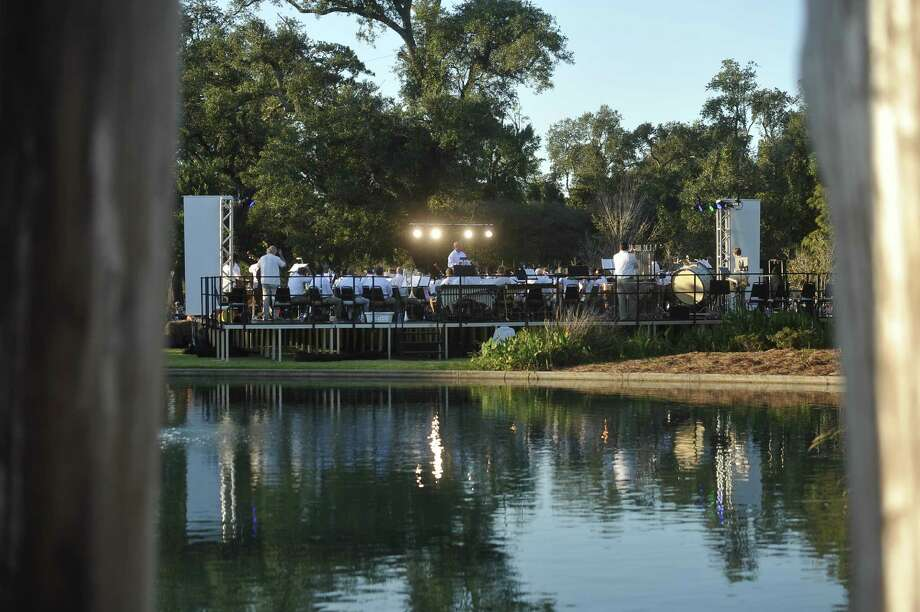The Symphony of Southeast Texas plays a concert for a crowd of more than 1,200 Sunday at Shangri La Botanical Gardens and Nature Center.