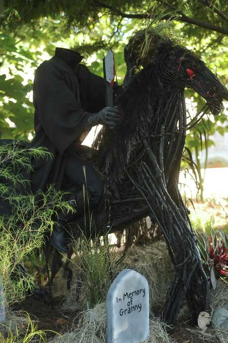 "A headless horseman scarecrow is on display at Shangri La Botanical Gardens and Nature Center. The annual scarecrow festival coincided with the first ""Symphony at Shangri La."" Photo: Michelle Heath"