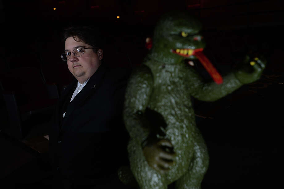 Steven Zani, a professor of English and Modern Languages at Lamar University, is lecturing Monday at the University Theatre on monsters and other iconic cultural creatures people love to fear. Among the props that will make an appearance is his fire breathing Godzilla statue.