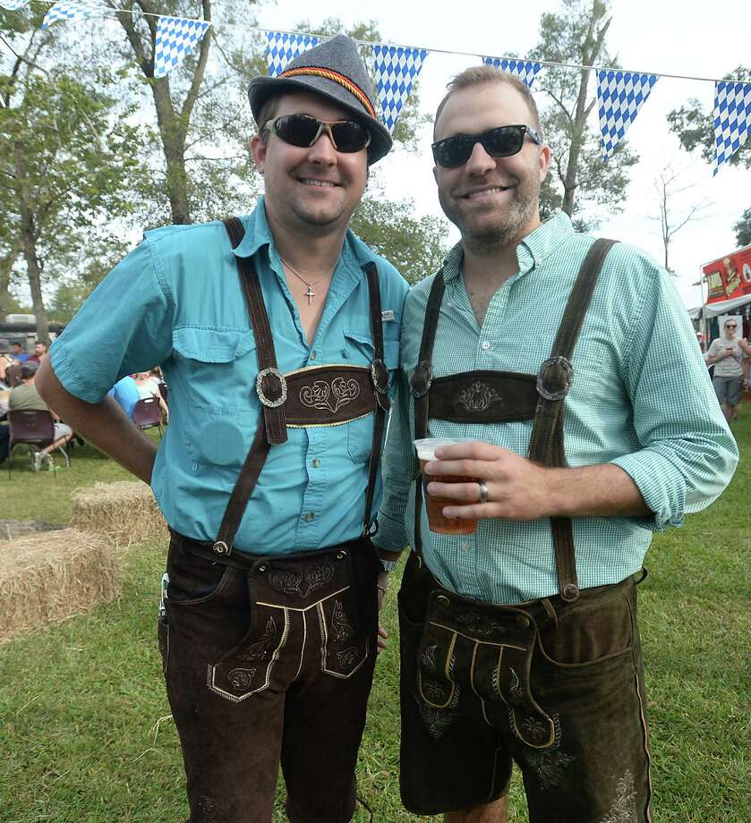 Brothers Aaron and Wade Aguillard donned lederhosen to get into the spirit of  Beaumont's first Oktoberfest, held Saturday in Rogers Park. Entertainment, including a polka performance by The Royal Klobasneks, German fare, and of course beer were among the star attractions of the festival. Photo taken Saturday, October 17, 2015 Kim Brent/The Enterprise Photo: Kim Brent / Beaumont Enterprise