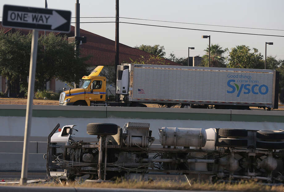 San Antonio police work Monday October 19, 2015 on westbound Loop 1604 between highway 281 north and Stone Oak Parkway where an empty concrete truck overturned about 8:20 a.m. on the right hand shoulder. There were no injuries but traffic on westbound Loop 1604 in the area has been backed up for more than an hour. Photo: John Davenport, San Antonio Express-News / ©San Antonio Express-News/John Davenport