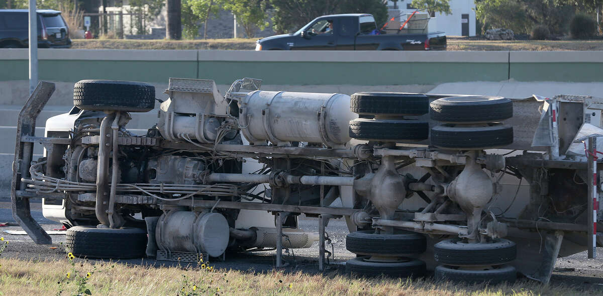 San Antonio police work Monday October 19, 2015 on westbound Loop 1604 between highway 281 north and Stone Oak Parkway where an empty concrete truck overturned about 8:20 a.m. on the right hand shoulder. There were no injuries but traffic on westbound Loop 1604 in the area has been backed up for more than an hour.