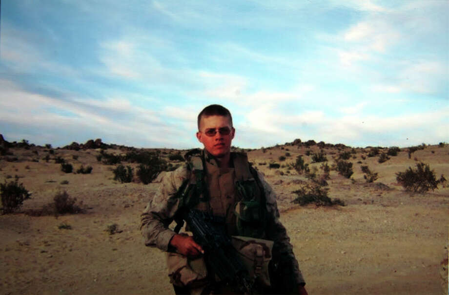 Contributed photo 5/24/07  Cpl. Jordan Pierson of Milford on patrol in Iraq. Photo: Contributed