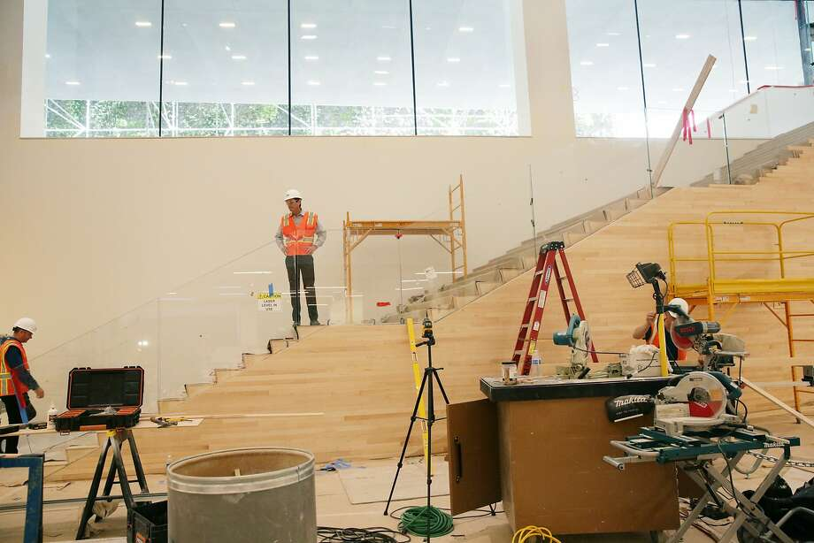 San Francisco Museum of Modern Art director Neal Benezra (right) stands on stairs in Schwab Hall as lead architect Craig Dykers (left) climbs the first step in  the San Francisco Museum of Modern Art during it's expansion on Thursday, October 8,  2015 in San Francisco, Calif. Schwab Hall will be a central gathering point and ticketing area. Photo: Lea Suzuki, The Chronicle
