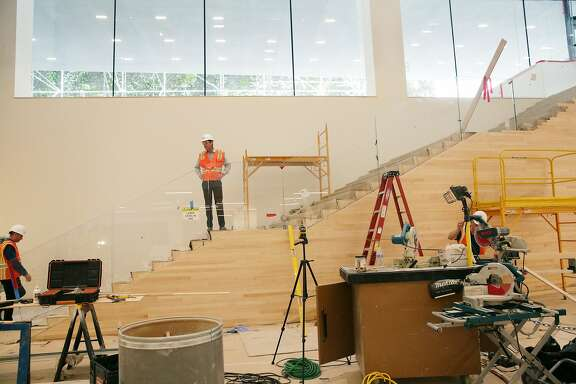 EMBARGOES FOR PRINT UNTIL 10/21 AND ONLINE TBD PER LEBA HERTZ.  San Francisco Museum of Modern Art director Neal Benezra (right) stands on stairs in Schwab Hall as lead architect Craig Dykers (left) climbs the first step in  the San Francisco Museum of Modern Art during it's expansion on Thursday, October 8,  2015 in San Francisco, Calif. Schwab Hall will be a central gathering point and ticketing area.