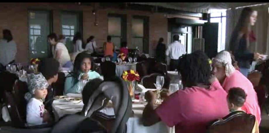 After a groom got cold feet and called off the wedding, the bride's family donated the reception meal to Sacramento's homeless on Saturday. Photo: Courtesy KCRA