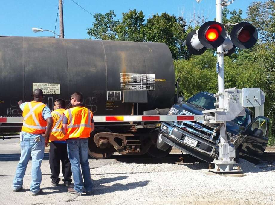 A man was injured Monday morning after police say he tried to go around a train at North Street at Gulf Street. Guiseppe Barranco/The Enterprise Photo: Guiseppe Barranco